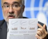 Secretary-General of the World Meteorological Organization Michel Jarraud shows the new WMO Greenhouse Gas Bulletin during a press conference of the United Nations' weather agency on November 9, 2015 in Geneva. Concentrations of carbon dioxide and other greenhouse gases in the atmosphere hit a new high in 2014, the UN said Monday, calling for urgent action to rein in climate change.  AFP PHOTO / FABRICE COFFRINI